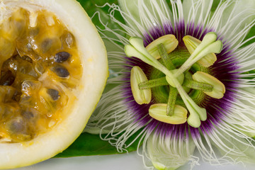Passion fruit flower with ripe cut passion fruit, macro