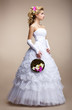 Wedding. Bride in White Dress and Gloves. Bouquet of Flowers
