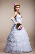 Wedding. Newlywed in White Dress holding Bouquet of Flowers