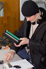 Man working toner cartridge
