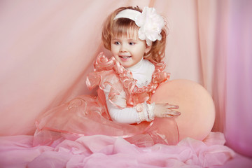 Beautiful girl, portrait of funny lovely little girl playing on