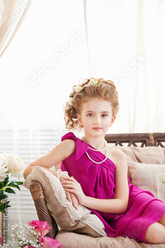 Little girl lying on the sofa