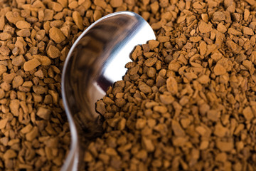 Spoon of coffee at coffe background