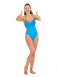 Full length portrait of happy young woman in swimsuit showing
