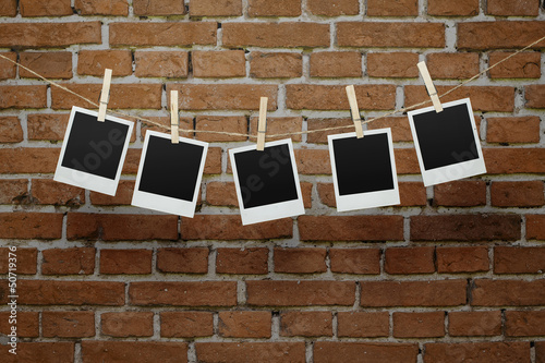 Blank photos over bricl wall with clipping path for the frames