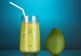 Useful fresh avocado on dark blue  background