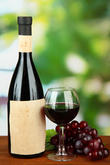 Composition of wine bottle, glass and  grape,
