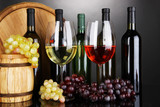 Fototapety Assortment of wine in glasses and bottles on grey background