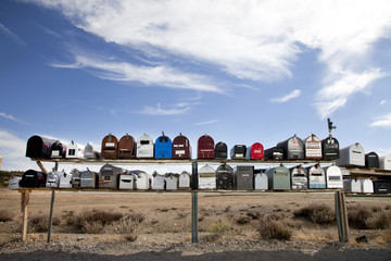 Front view of rows of mailboxes in desert