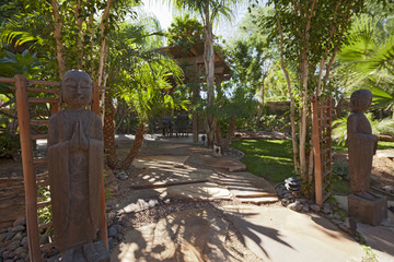 Relaxing garden with Buddhist statues