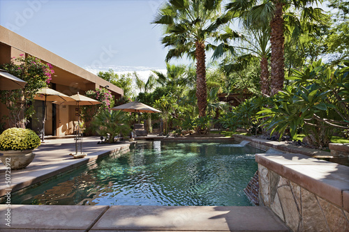 Luxury Villa with waterfall feature and palm trees