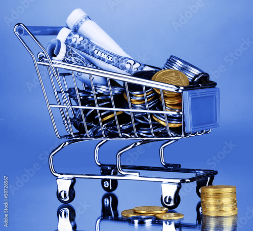 Money in cart in blue light