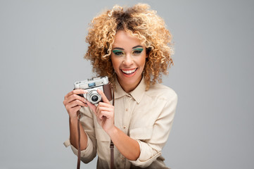 Afro Woman with a Retro Camera