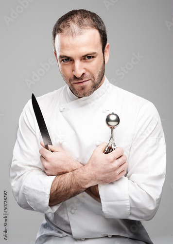 Mad Chef Holding Kitchen Tools