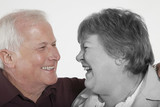 Senior couple looking at each other against white background