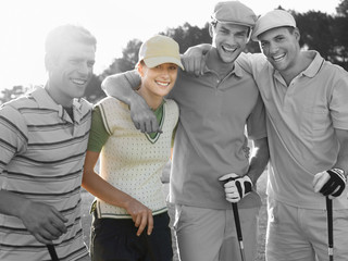 Portrait of four young friends at golf course