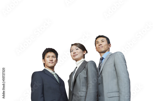 Businesspeople standing together against white background