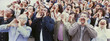 Panoramic shot of crowd shouting with hands on face