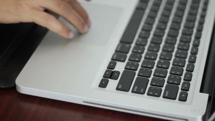 male hand press enter on laptop keyboard