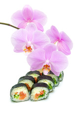 orchid and sushi on a white background close-up