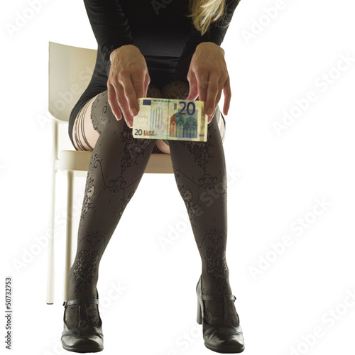 Young female holding 20 euros in her hand