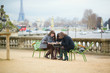 Tourists in Paris planning their trip using map