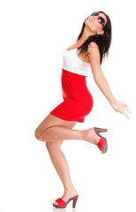 Happy surprised woman in red dress Isolated