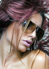 Woman with sunglasses and beautiful hair