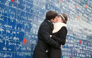 Couple kissing on Montmartre in Paris
