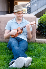 young male student with ukulele