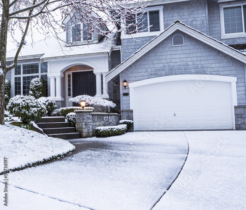 Snow on Driveway leading to home - 50736197