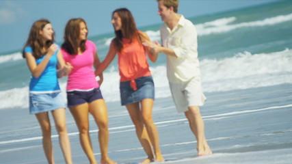 Happy Caucasian Family Walking Ocean Shallows