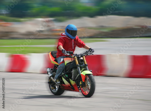 Poster motorcyclist rushes on motorcycle