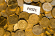 Prize sign at a stack of golden coins