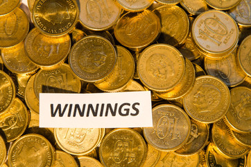 Winnings sign at a coin stack