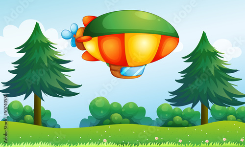 A colorful aircarft above the hill