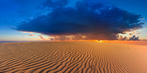 dramatic sunset among a desert
