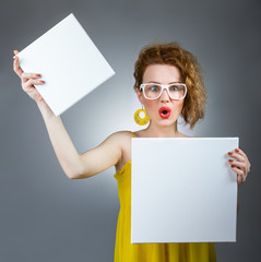 Surprised woman holding white board