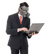 Busniess man with gas mask using laptop, isolated on white