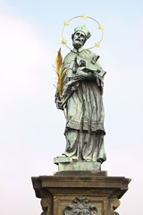 One of sculptures on the Karlov bridge in Prague