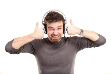 Attractive young man wearing headphones on white background