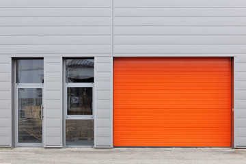 Industrial warehouse with orange roller door