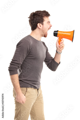Young man shouting through megaphone