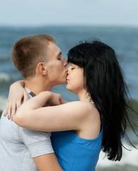 Guy is kissing his girlfriend