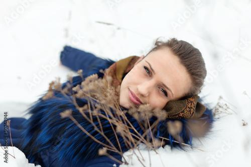 Girl lying on snow