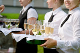 Fototapety Waitress with dish of champagne glasses