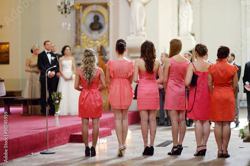 Row of bridesmaids in coral dresses