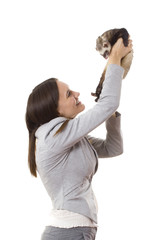 Lady holding a ferret