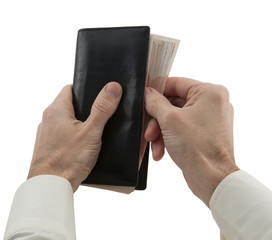 man's hands hiding wallet with banknote
