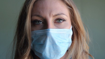 Young woman with medical mask.